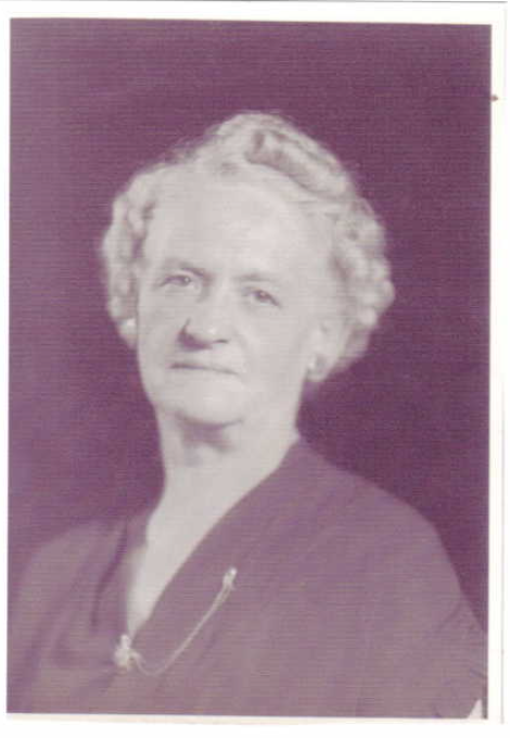 Photo of Gertrude Edna Reynolds– Mrs. Gertrude Edna Reynolds of Chatham, Ontario, was the 1956 National Memorial (Silver) Cross Mother. During the national Remembrance Day ceremony in Ottawa on November 11, 1956 she laid a wreath at the base of the National War Memorial on behalf of all mothers who have lost a child in military service to Canada.