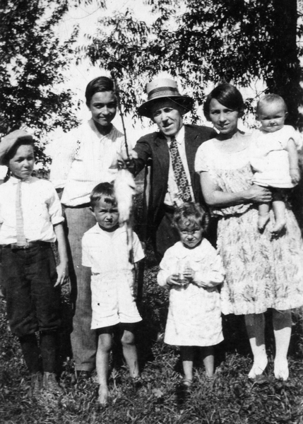 Family Photo– Richard and his family.  Richard, at 5 years old, is in the bottom row with his sister Marguerite.  The other family members, left to right, include his brother Herbert, brother George, father Richard, and mother Lucy, holding baby Marie.