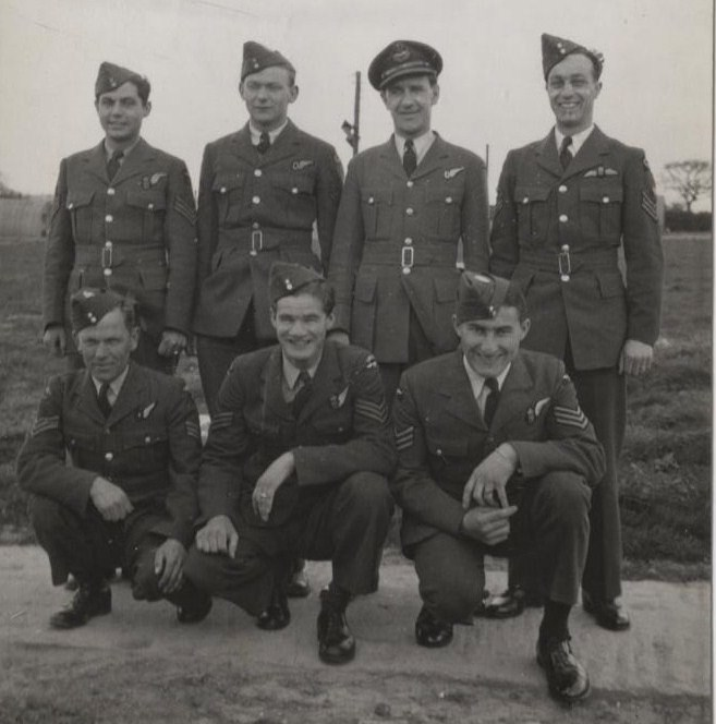 "Group photo– Group Photo – April 1944, the original ""Bob' Lamb's Crew"" formed up at #24 A.T.U. Honeybourne in December 1943. They finished the course together and flew an Operation on March 1, 1944, dropping Leaflets over Chatres, France in a Whitley Bomber, while shot at by a Fighter. They started the last Course, H.C.U. #1666 at Wombleton, when Wallace Oatway was Hospitalized. The rest joined 426 Squadron and flew Operations until they crashed. A month later Wally Oatway was on Leave from 424 Squadron sitting in the York Train Station, when his replacement ""Phil"" Longley walked over and told him the story. From Top Row L-R, top: Bob Kipfer Wireless-Survived, Bob Mallalue Navigator-Survived, P/O Wallace Oatway Air Bomber-(survived the War), P/O Robert Lamb Pilot-Killed. Bottom Row L-R, P/O Norman Kingslay Robinson RAF Engineer-Killed, Sgt. William Baker Wright Rear Gunner-Killed, Sgt. Albert AJ Willis Upper Gunner-Killed. (Phil Longley not in photo)"