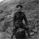 Photo 2 of James Leonard McQuay– Sapper James Leonard McQuay, no. 622, next to a trench of barbed wire.