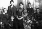 Cahill family photo– Cahill family photo, taken in 1897, John is the boy in the front, Martin is located at the extreme left.