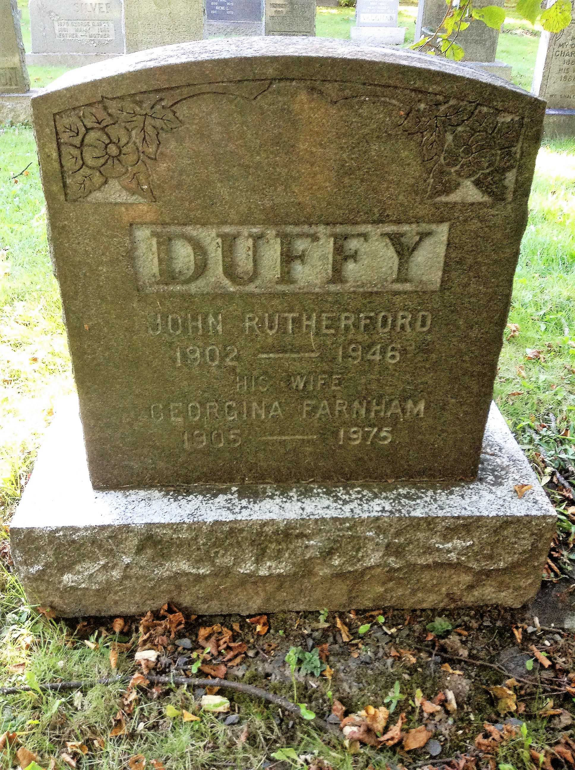 Grave Marker– Family grave marker with inscriptions for John Rutherford Duffy and his wife Georgina Farnham at Camp Hill Cemetery in Halifax, Nova Scotia.