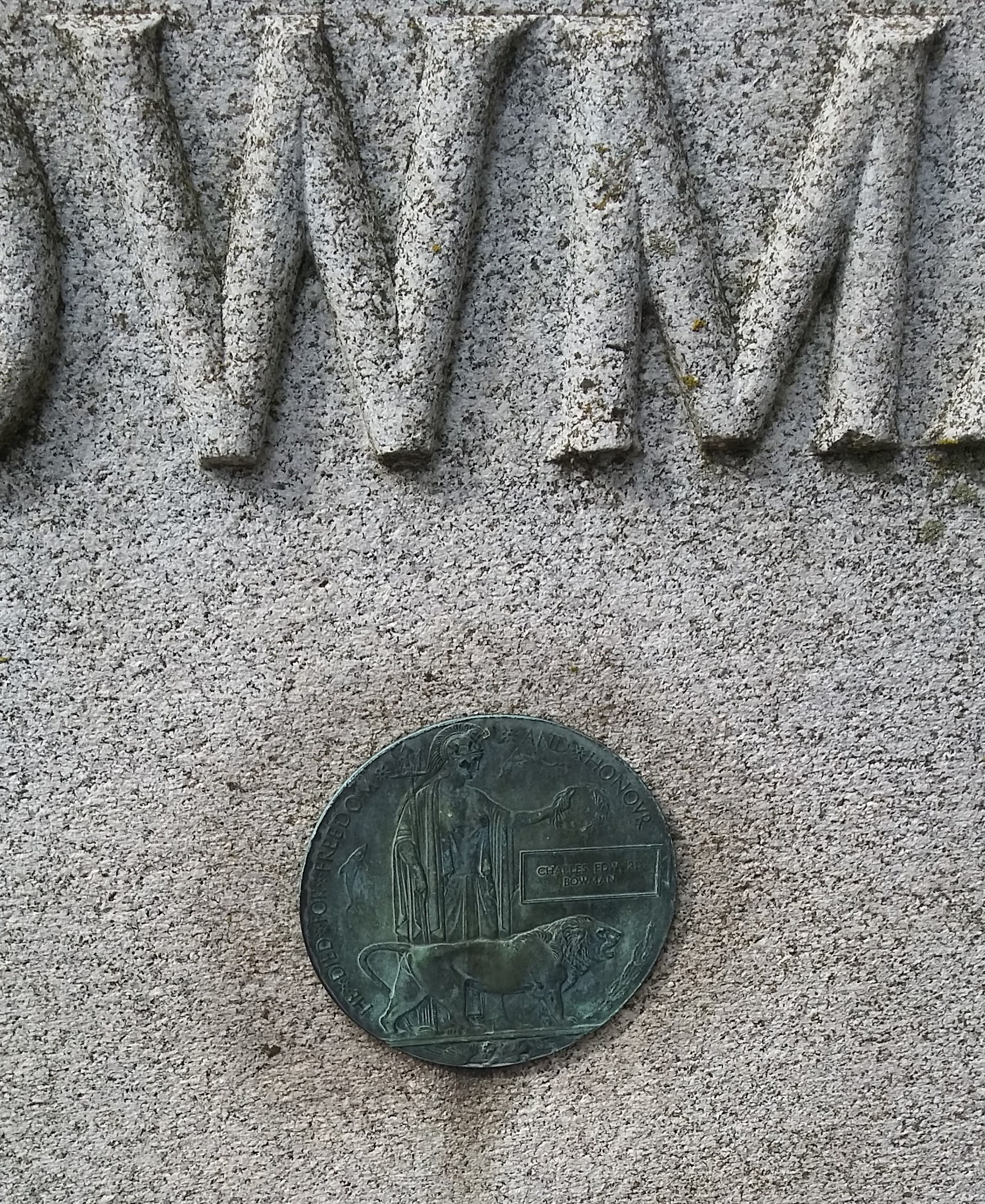 """Inscription– Close up photo of memorial to Charles Edward Bowman showing his """"Dead Man's Penny"""" mounted to the stone, Ingersoll Rural Cemetery; Bowman Family plot"""