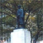 """Sons of England War Memorial– Designed by Charles Adamson in bronze and granite, the Sons of England war memorial is located on University Avenue at Elm Street in Toronto.  The inscription on this 1923 Memorial reads:   """"ERECTED BY MEMBERS OF TORONTO DISTRICTS SONS OF ENGLAND BENEFIT SOCIETY IN MEMORY OF THOSE WHO FELL IN THE GREAT WAR""""."""