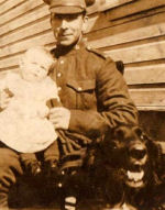 Group Photo– My Great Grandfather with his eldest daughter Mary sitting on his knee, just before he deployed