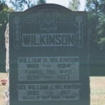 "Gravemarker in Queensborough Ontario– Photograph showing the grave marker of William Wilkinson's parents in a small quiet cemetery near the now, almost deserted village of Queensborough Ontario. On the grave stone is a memorial to their son: ""Sgt. William J. Wilkinson 1893-1917 Killed at Vimy Ridge France"""