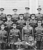 Group Photo– Photo:Machine gun section, 82nd Battalion, Canadian Expeditionary Force, Calgary, Alberta.  L-R back row: W. de Mandey; F. Hills; F. Telford; H. Clowes; L. Allison; H. Hickey; W. Smitherun; F. Wells; M. Birchenough; S. Brown. (All others in the photograph are unidentified.) + Herbert Charles Hickey (marked with X in the back row), was born in 1893 and killed at Vimy Ridge in 1917. He is buried in Quatre-Vents Military Cemetery in Estree-Cauchie, Pas-de-Calais, France. He was born in Bristol and had worked for the CPR in Calgary.  Glenbow Archives credit