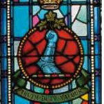 """Memorial Stained Glass– Ex-cadets are named on the Memorial Arch at the Royal Military College of Canada in Kingston, Ontario and in memorial stained glass windows to fallen comrades. 1011 Major John Garnett Tatlow MC (RMC 1914) was the son of Elizabeth M. Tatlow, of 3689, Cartier Av., Vancouver, British Columbia, and the late R.G. Tatlow. (Finance Minister of British Columbia.). He served with the Lord Strathcona's Horse (Royal Canadians), R.C.A.C., """"A"""" Sqdn. He died on 23 Mar 1918 at 21 years of age. He was buried in the Chauny Communal Cemetery British Extension in Aisne, France."""