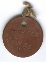 Identification Disc– Identification Disc, obverse.  Identification Tags (ID) were commonly called dog tags, and all Canadian Soldiers wore them.