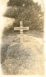 Original Gravemarker– Stanley Anderson Cornell's original grave and wooden cross taken just after his burial in 1919/20.  The grave behind Cornell was the end of the last WW1 row of casualties for Canadian soldiers, most have a February 1919 date whereas the row for Cornell is all January 1919.  The trees in the background were removed after WW2 to allow space for WW2 casualties and the footpath you can see on the right was also removed at the same time for the same reason so Cornell is now three headstones in from the end of the row whereas after WW1 he was positioned on the end of the row.