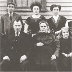 Family Photo– Family photo of Joseph Deschenes. His father and mother (Zoel and Clara Bois)surrounded by their children. Joseph is the 1st child on the left of the photo.