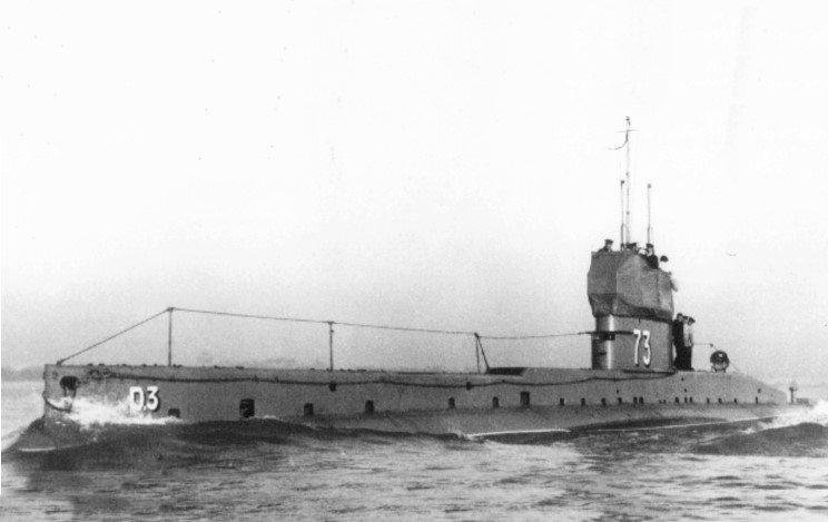 Photograph– Photograph of HM Submarine D-3, a British D-Class submarine, which was commissioned into service in 1911 and lost off the coast of France on 15 March 1918 with all 29 officers and men aboard.  It was the victim of an attack by a French airship whose crew had mistaken it for an enemy submarine.  At the time, the D-3 was commanded by Acting Lieutenant W.M. Maitland-McDougall RCN, a graduate of the Royal Naval College of Canada and the first Canadian naval officer to command a Royal Navy submarine.  (Submitted by Navy League Cadet Corps CHAMBLY, Barrie, Ontario.)