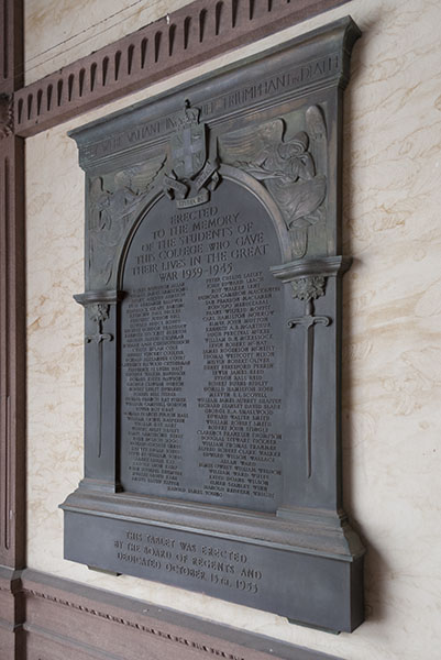 """Victoria College WWII Plaque– This outdoor plaque is located at Victoria College, part of  Victoria University in the University of Toronto. """"They were valiant in life and triumphant in death. (Victoria University Crest -  Abeunt studia in mores). Erected to the memory of the students of this college who gave their lives in the Great War 1939-1945. This tablet was erected by the Board of Regents and Dedicated October 13th, 1953"""". Among the 79 names inscribed is that of: """"George Gordon Bradshaw"""".  Photo: Cody Gagnon, courtesy of Alumni Relations."""