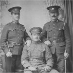 """Photo of Frederick Norton Warlow– Lance Corporal Frederick Norton Warlow (standing back left.) The cap badges worn by he and his seated pal are that of the 2nd British Columbia (Vancouver.)  See Rosen and Martin's """"CEF Military Cap Badges of World War I"""", badge reference E-30A."""