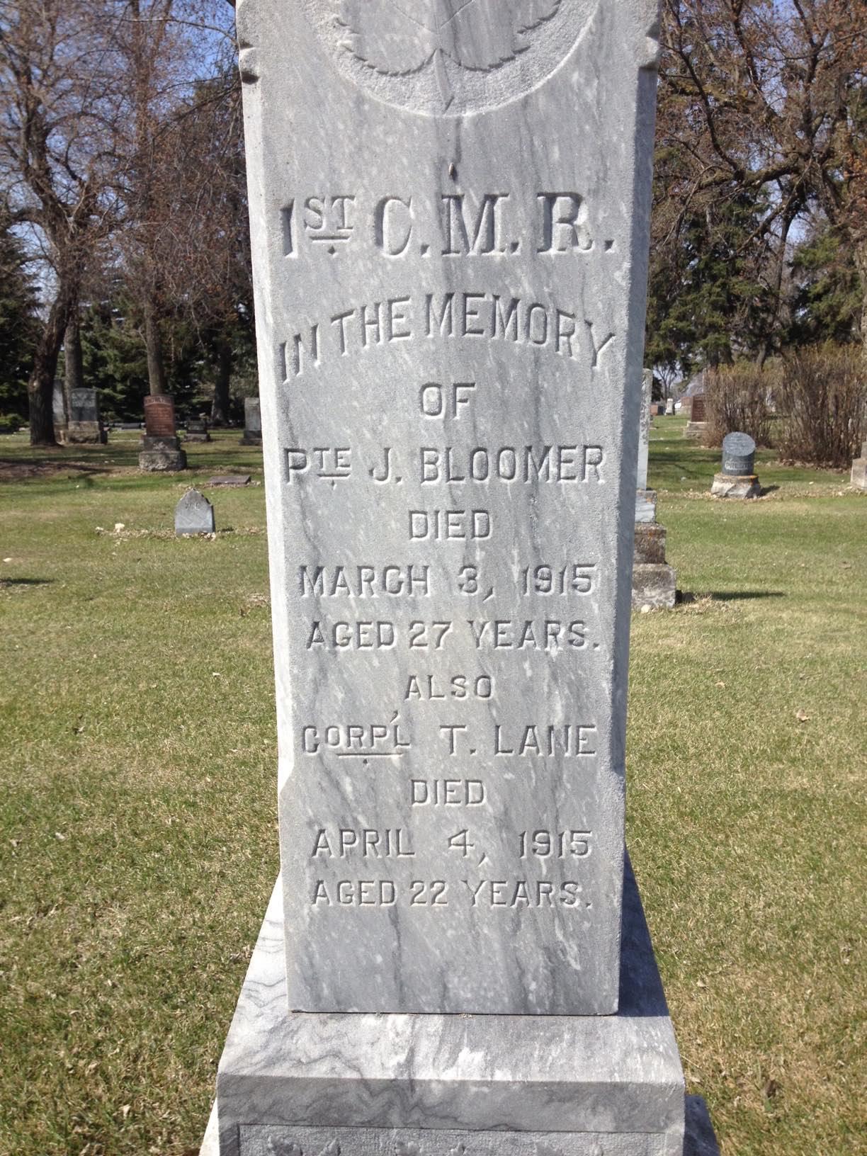 Inscription– Closeup of original grave marker for Pte Bloomer (1st CMR) at the Brandon Municipal Cemetery (Brandon, MB, Canada), Section 16 Block C Plot 24