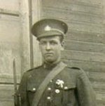 Photo of Louis-Vital Bisson– Private Louis-Vital Bisson, 3381318.  Photo taken in the summer of 1918, near the family home in Chartierville, which was located opposite the church.  Louis-Vital Bisson was born on December 28, 1896 in this house.  He died from the Spanish Influenza on October 22, 1918.