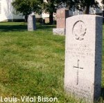 Gravemarker– Gravemarker of Private Louis-Vital Bisson in the Chartiervile Cemetery.  The family home is in the background.