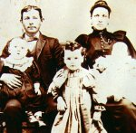 Family photo– Vital Bisson and his wife Clémence Blanchette with their three living children in 1897.  Philias-Polycarpe is in his father's arms while Marie and Louis-Vital are in the arms of their mother.