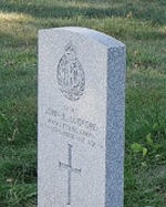 Grave Marker– The grave of Cadet John Edward Ludford, who was killed in a flying accident. The grave is located in St. Mary's Catholic Cemetery, 208 Sunnidale Road, Barrie, Ontario. (Image taken by Gregory J. Barker of Barrie in 2012. This image may be copied and used without further permission.)
