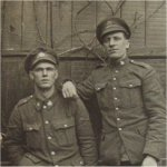 """Photo of Joseph Walter Poznik– Pvt. 823849 Joseph Walter Poznik (Left seated) 142nd Battn. C.E.F. Enlisted May 23rd 1916, He listed his occupation as """"Cook"""" He died at age 27 on Aug. 2nd 1916 (Less than 3 months service)  Born in Russia in 1888 he immigrated to America in 1905 settling in the ST. Louis MO. area before enlisting in the Canadian army. He also served 29 months in the U.S. Army (Peace time) Photo is ID'ed on back."""