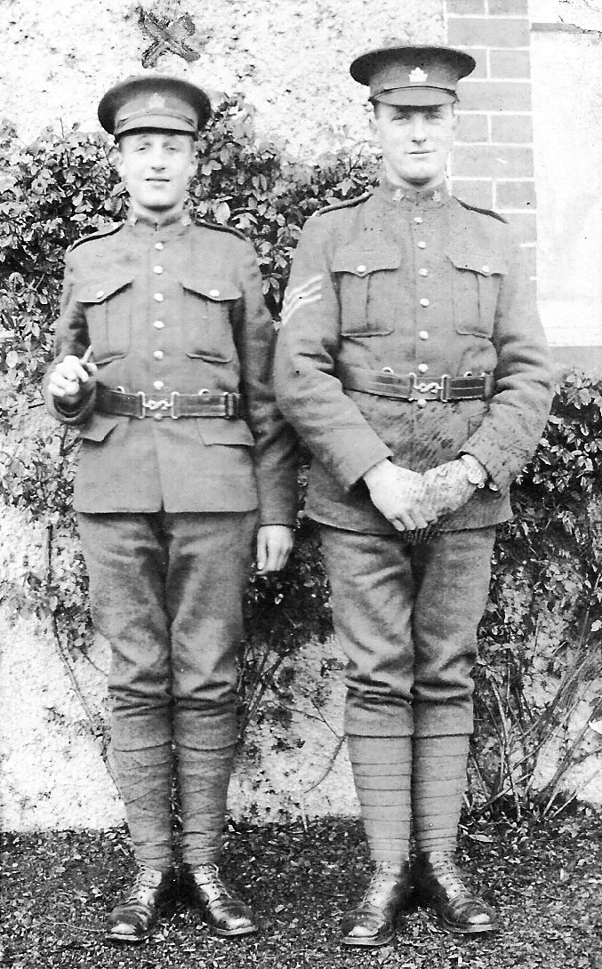 """Group Photo– John Shaw (603137, died 3 weeks after Robert) on the left; Robert Howe (602253) on the right. Robert's military record shows he was a Sgt. In handwriting, on the reverse of the photo: """"Loyal chums to the end Pte Shaw Sgt Howe"""""""