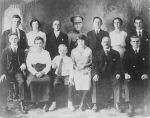 McNeilly Family– The family left allowed space during the photography sitting to superimposed David into the family photo.  Back row: Robert, Lizzie & husband George, DAVID MCNEILLY, Samuel and wife Edith, William  Front row: John, mother Agnes, Thomas, Charlotte, father David, Jospeh
