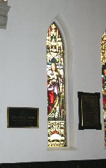 Photo 2 of Memorial Plaque– The Memorial plaque for Lt. Henry Richard Thomson is located to the left of the stained glass window in this photograph.  Church of the Ascension, Hamilton, Ontario.