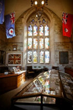 Memorial Room– Memorial Room, Soldiers' Tower, University of Toronto.  In the background at photo left can be seen the King's Colour of the 2nd Canadian Pioneer Battalion. Often such colours are laid up in churches; however this artifact was presented to the University because many of the battalion's officers were graduates. Photo by David Pike, 2010; submitted by K. Parks, Alumni Affairs.