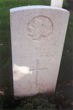 Grave Marker– A photograph of the headstone at the Ramparts Lille Gate Cemetery, just inside the Lille Gate at Ieper (Ypres), Belgium. May he rest in peace. (J. Stephens)