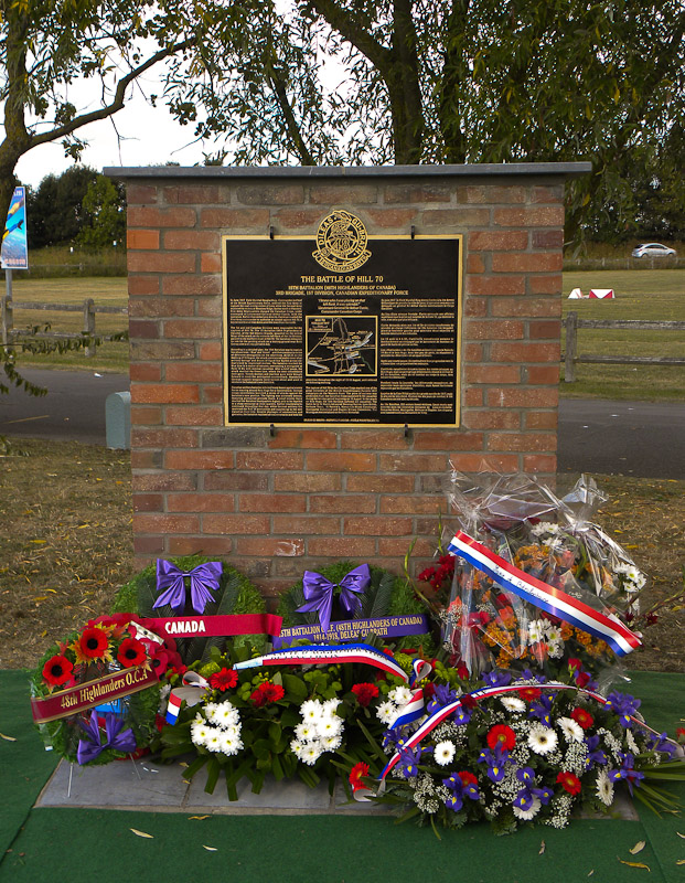 "Hill 70 Memorial– ""The Hill 70 memorial, erected by the 15th Battalion Memorial Project and the town of Benifontaine, was unveiled and dedicated on 22 September 2012. The memorial commemorates the actions of the 15th Battalion CEF, which was on the extreme left flank of the Canadian assault on Hill 70, on 15 August 1917 and the memory of those members of the Battalion who fell during the engagement. The memorial sits on what was then known as Bois Hugo, which the Battalion assaulted, captured and held against repeated German counterattacks.""