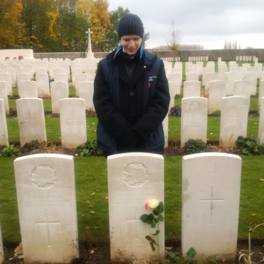 Grave Marker– Government of Canada Youth Delegate Ben Jamieson at the grave of Thomas Sherlock.