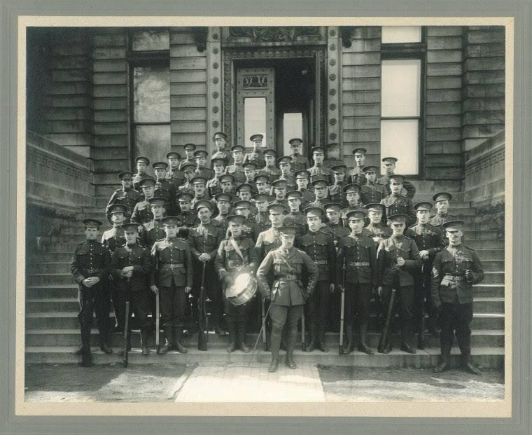 Group Photo– Lieut. Pope standing at centre, with his McGill Overseas Company in front of the Redpath Museum 1915.