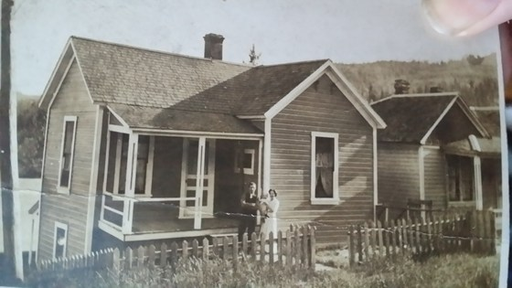 Home– View of Edward outside house in Rossland, BC, before departure to Europe for the 'Great War'. Taken with wife Mary and daughter Edna.