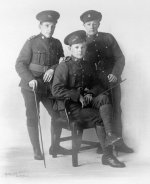 Photo of J.C. McRobert and two friends– JC McRobert seated, along with two unidentified friends from the 4th battalion. Photo taken in England 1916.