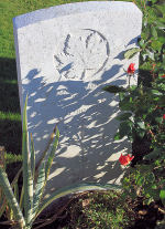 Photo of the grave marker– The grave marker at the Railway Dugouts Burial Ground Cemetery located approximately 3 kilometres to the south of Ieper, Belgium. May he rest in peace. (J. Stephens 2010)