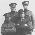 Photo of George Alexander Brown– Private George Alexander Brown (left front), his father-in-law Octave Poirier (right front), his brother-in-law Private J. Emile Poirier (left rear), and his brother Private Frank Sirril Brown (right rear).  Photo taken in 1916 when all three Privates were in the 203rd Battalion, prior to being shipped overseas to fight with the 27th Battalion (City of Winnipeg).