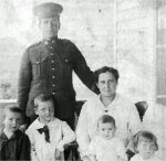 Family Photo– Private George Alexander Brown with his wife Hedwidge and their children (from left to right) George, John, Irene and Mary.  Photo taken in Transcona, Manitoba in 1916.