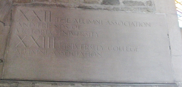 """Memorial– Inscription in Memorial Room, Soldiers' Tower.  The carillon was installed in 1927.  Originally there were 23 bells. Alumni and friends donated funds for bells in memory of those who died in the Great War. Dedications are carved high on the walls of the Memorial Room. Bell XXII is dedicated: """"The Alumni Association and friends of Victoria College""""."""