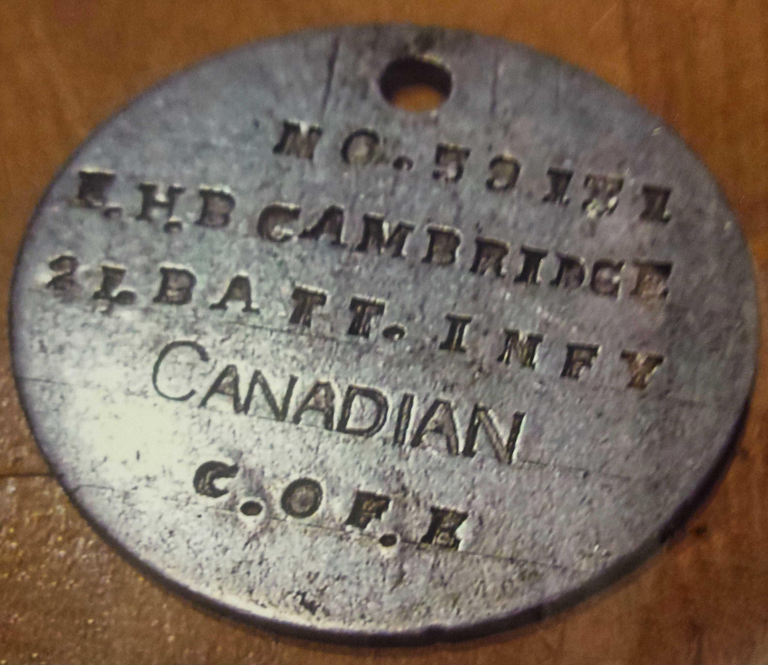First World War dog tag– WW1 tag belonging to Edward H.B. Cambridge.