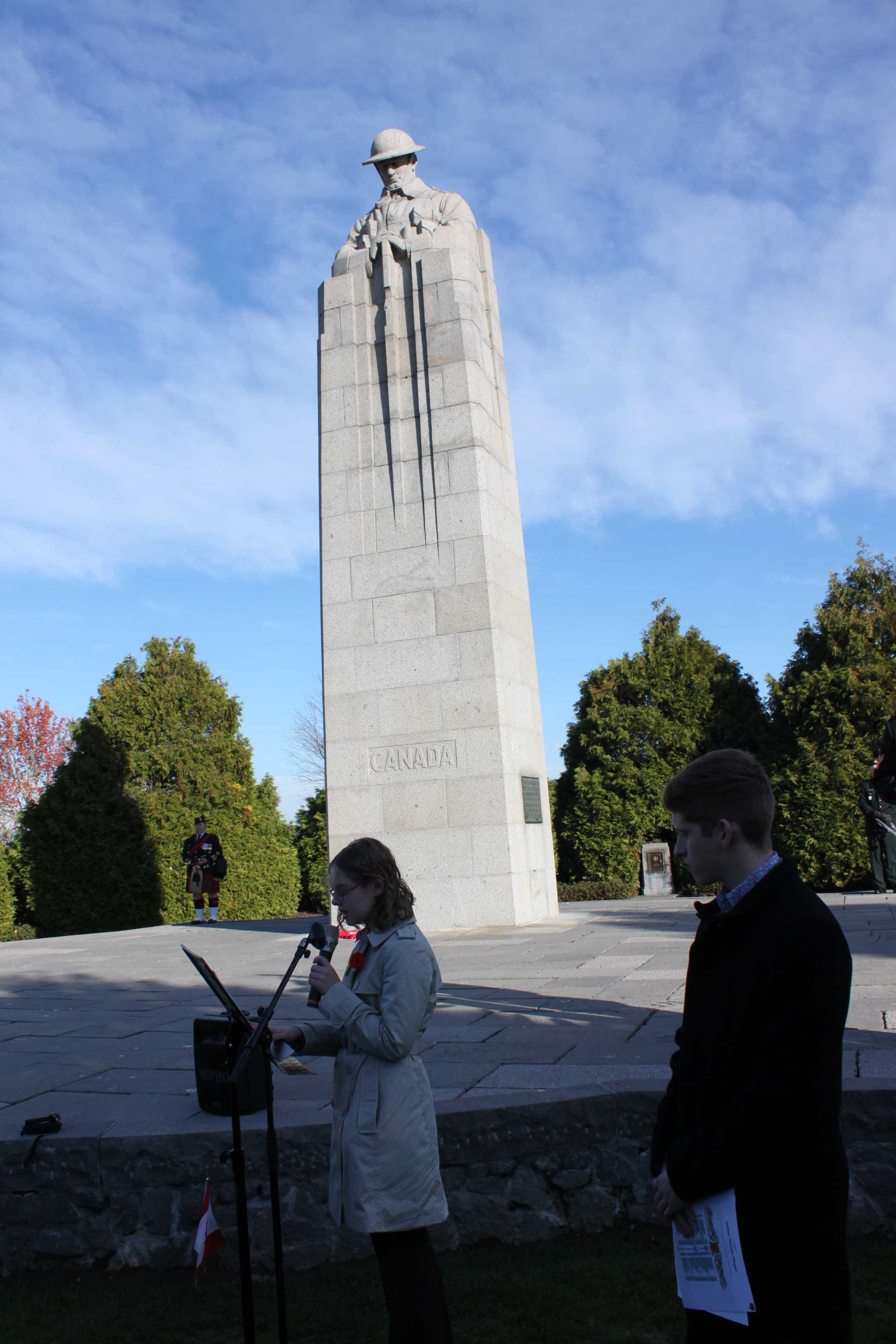 Photo– Youth delegate presenting the research project at St. Julien Canadian Memorial on November 9, 2018.
