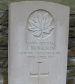 Grave Marker– Canadian pride - A poppy cross and a Canadian flag were placed at the grave site of James (Jimmy) Morrison to show a family's love and respect for a fallen soldier