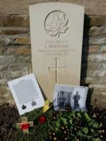 Grave Marker– Here is a picture of Jimmy that was taken before the war, a photo of Jimmy and his father, and a poppy cross that was left at his gravesite during my last visit.