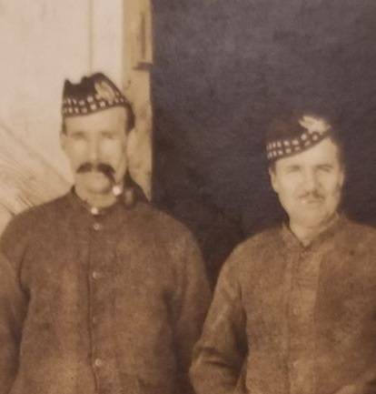 Photo of DONALD MCLEAN– Picture postcard sent to his niece, Mary McLean Liddell, by Donald McLean. He is the gentleman in the middle. Taken in front of a stable where he and his battalion were billeted (4 to a stall, according to what he wrote on the back of the postcard).