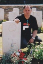 Grave marker (2)– Photo of nephew at grave site.