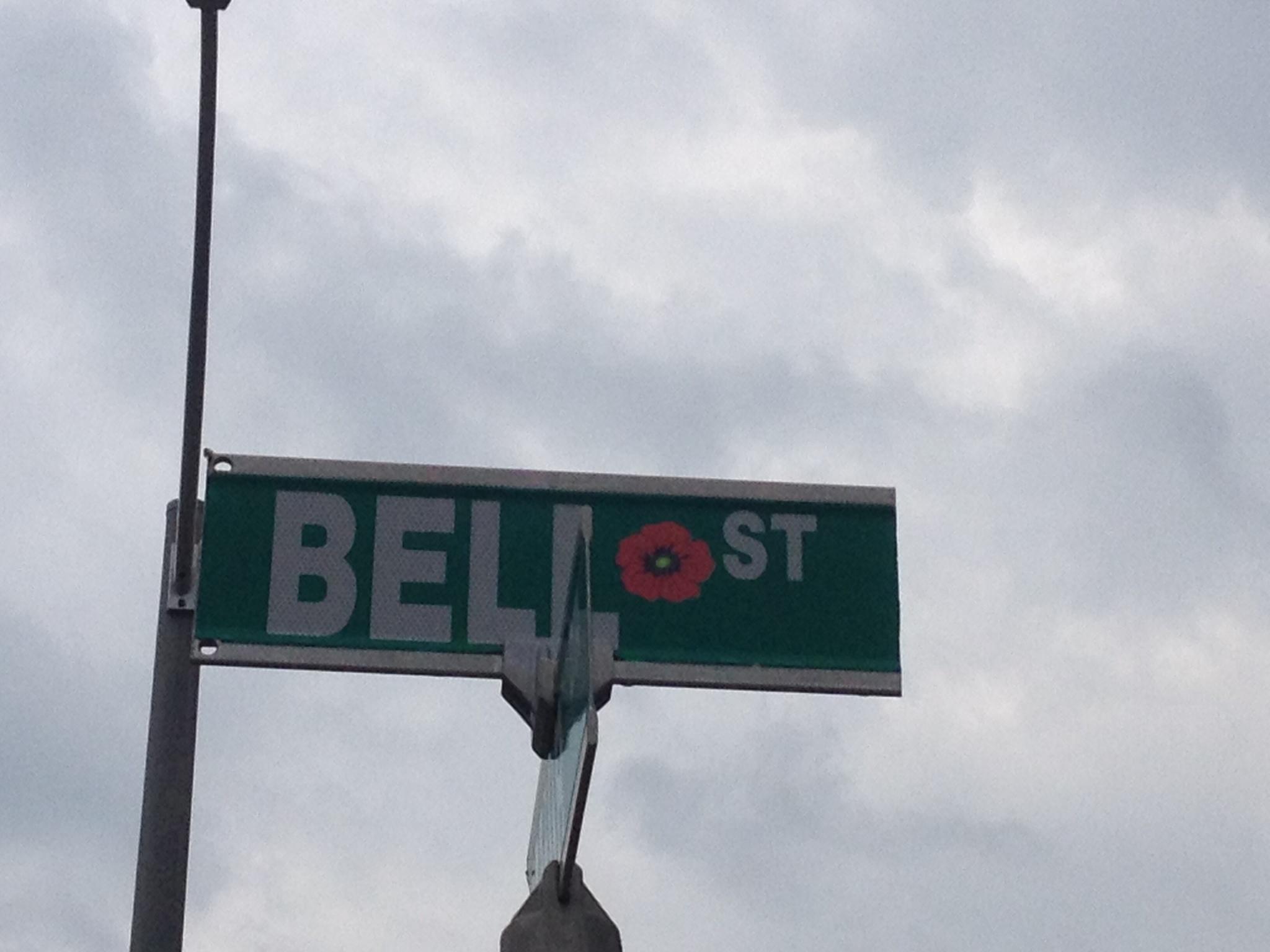 Street sign– Barrie street named in honour of Lieutenant Arthur Egbert Bell with a poppy.