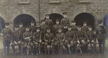 Group Photo– A group picture of some of the Newfoundlanders who served in the First World War.  Left to Right / de gauche à droite:  Back Row / Dernier Rang: Pte. H. Wilson, Pte H. Lidstone            Second Row / Deuxième Rang: Pte. C. Peet, Pte. J. Cleary, Pte. D. Osmond, Pte. A. Small, Pte. T. Smythe, Pte. W. Bradley  First Row / Premier Rang: Bugler J. Nicholl, Pte. C. March, Pte. F.P. LeGrow, Col. Sgt. G. Taylor, Lieut. C.A. Ayre, Lieut. J. Nunns, Sgt. W. Ayre, Cpl. R. Sheppard, Pte L.G. Harsant, Bugler W. Taylo