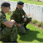 Remembering the Fallen Canadian Heroes– Corporal Troy Doley and Cpl Brady Stoddart of 1 PPCLI remember a fallen comrade at a graveyard at the Canadian National Vimy Memorial in France during a visit to the site on their way to the 2003 Nijmegen Marches in Holland.  Photo by Sgt Jerry Kean,  Canadian Forces Imaging Tech, Vimy, France 12 July, 2003.