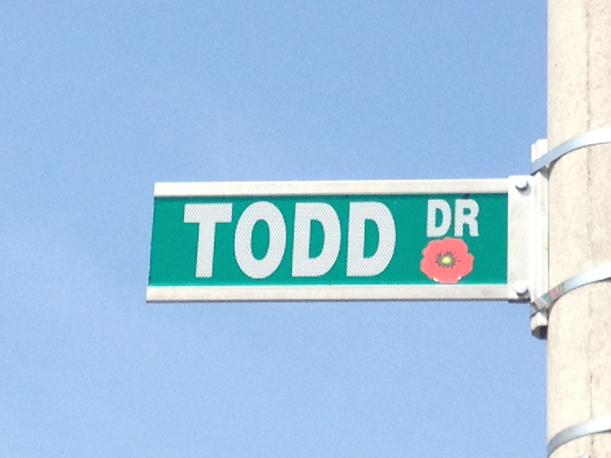 Street sign– Barrie street named in honour of Private Robert Wilfred Todd with a poppy.