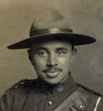"""Photo of Howard Sparling– 1915 on a photo postcard.  """"The hat came from Jack Lowes in Saskatoon""""."""