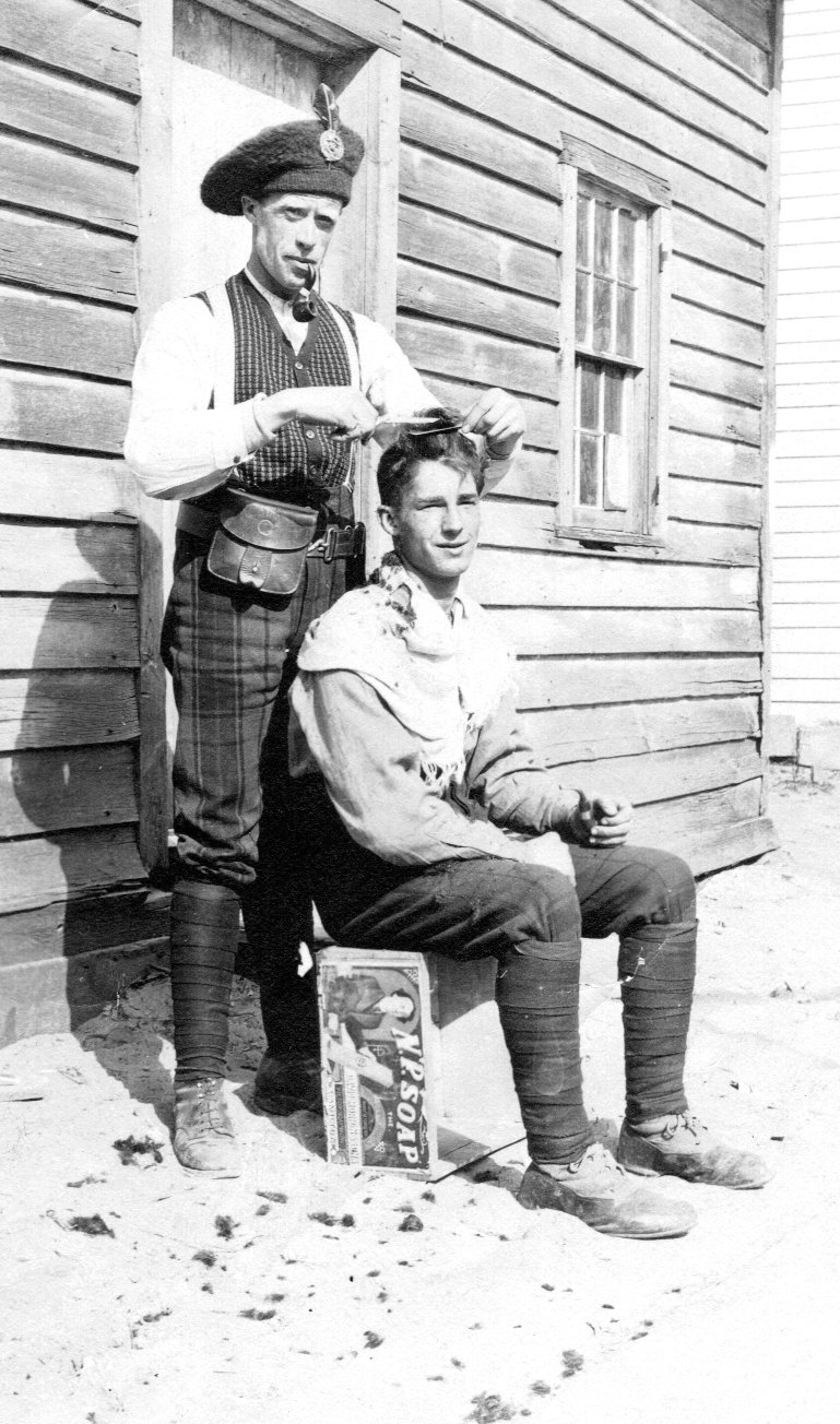 Photo of PETER REID– Peter Reid trimming a friends hair.  Peter left his home in Dumfries and Galloway, Scotland in 1910 and, following his arrival in Canada Peter worked as a Carpenter, met and become engaged to a young lady and on 1st November 1915 signed his Attestation Paper as Private 201889 Peter Reid.  As part of the CEF Peter became part of the 95th Battalion and was sent to fight in the Somme.  Peter was injured in his first battle and lay in no man's land, unable to move, for three days and nights before being found.  Peter was nursed in a field hospital then returned to England's King George Hospital where he died 1 month after being injured.
